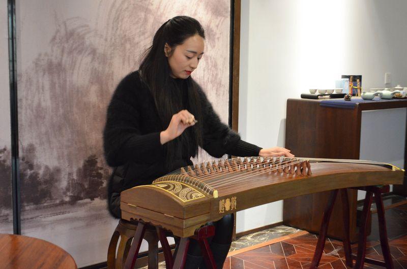 Playing a guzheng