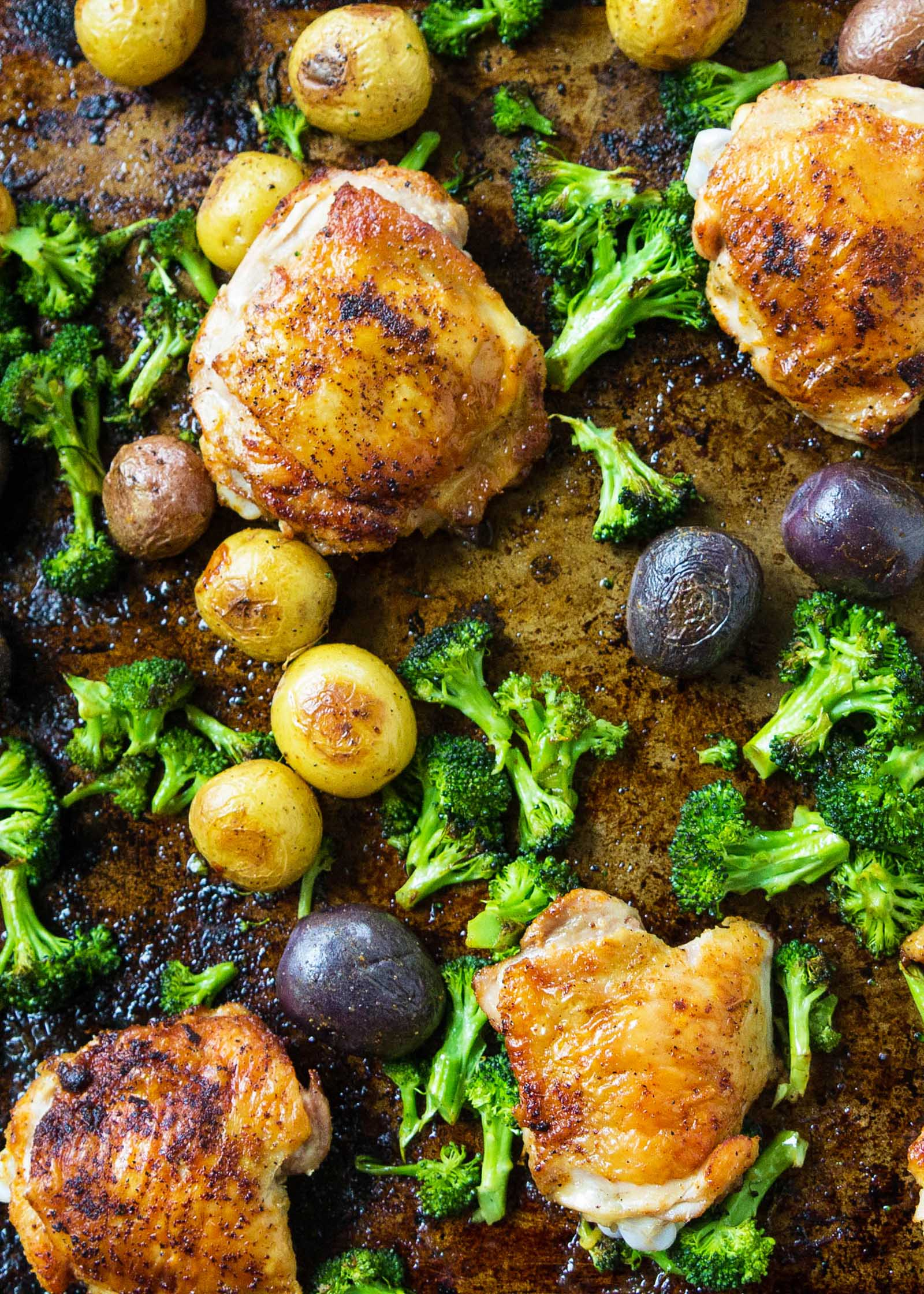 Sheet Pan Chicken with Roasted Broccoli and Potatoes from simplyrecipes.com on foodiecrush.com
