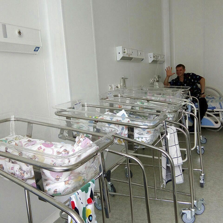 Father with kids in maternity hospital