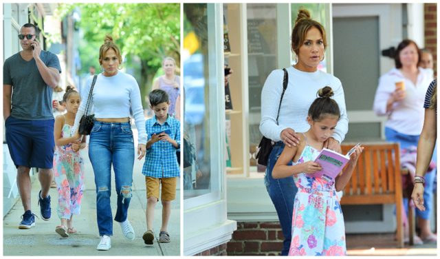 Jennifer Lopez walks down the street with children