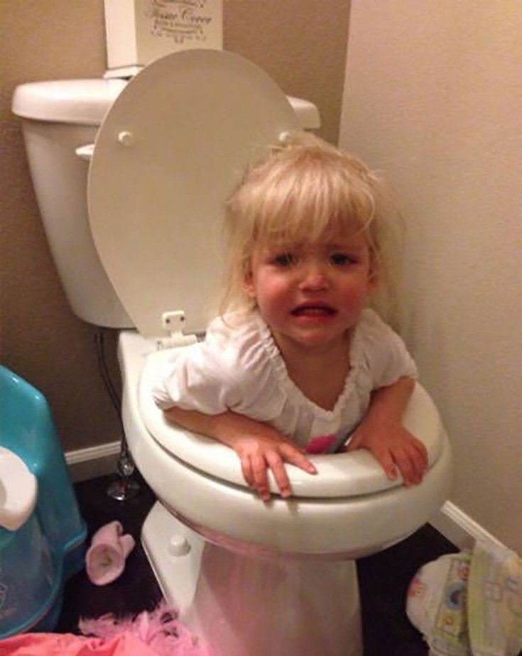 The girl is stuck in the toilet