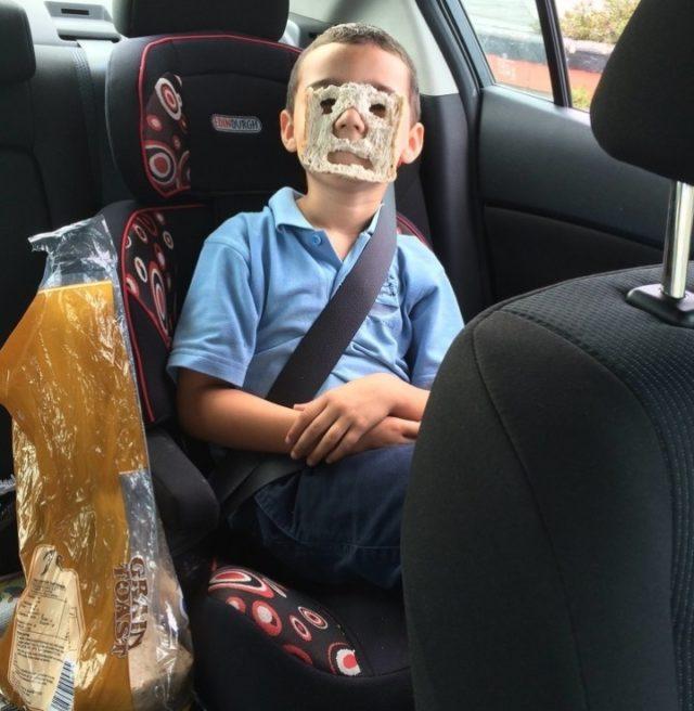 Boy with sandwich mask