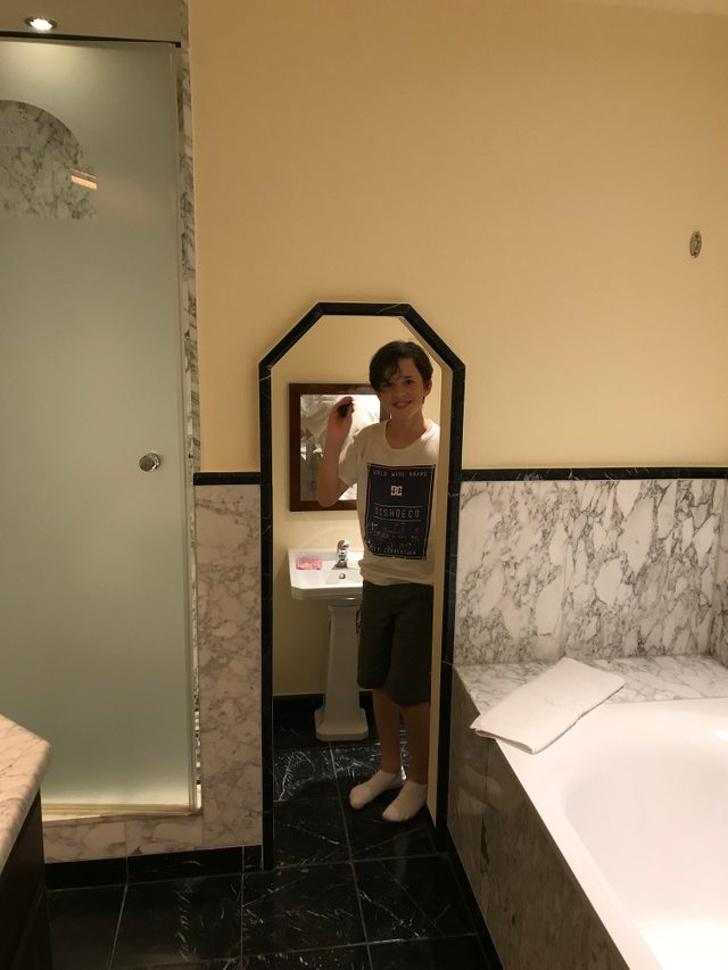 Boy in hotel bathroom