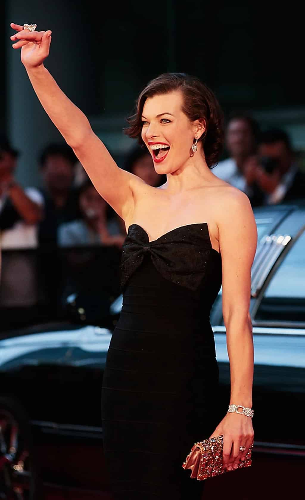Mila Jovovich in black