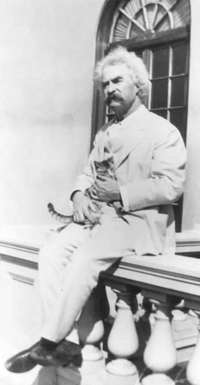 Mark Twain with a cat in his arms