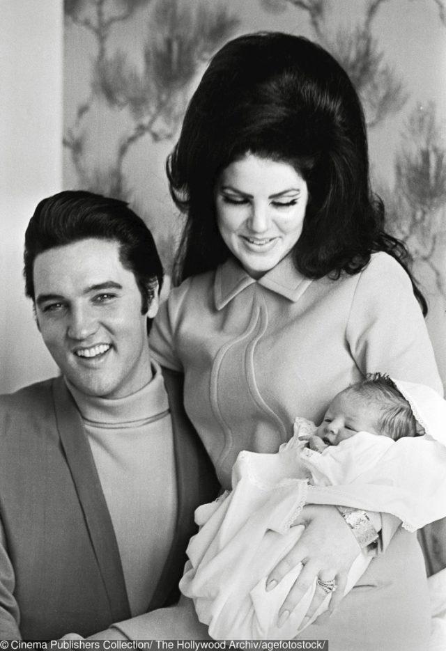 Elvis and Priscilla Presley with a newborn daughter