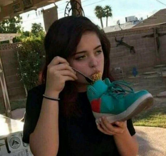 girl eats from a sneaker