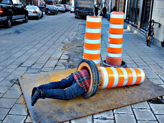 man in a traffic cone