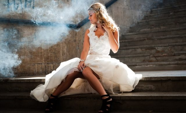 girl sitting on the steps in a white dress