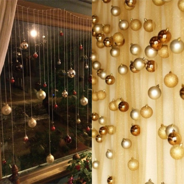 Christmas balls on the window and curtain