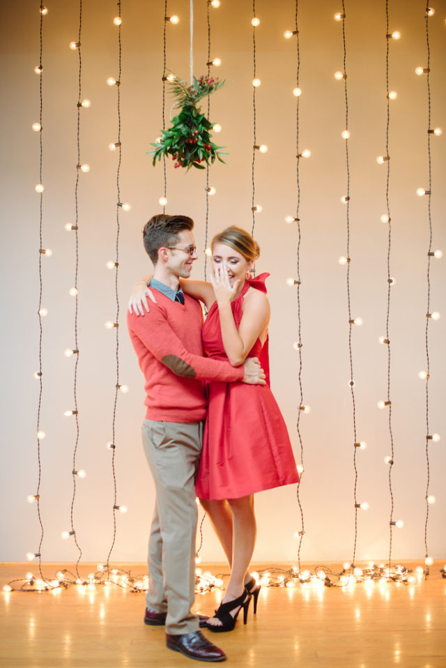 guy and girl on the background of a garland