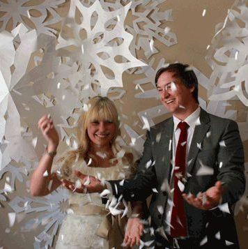 boy and girl among paper snowflakes