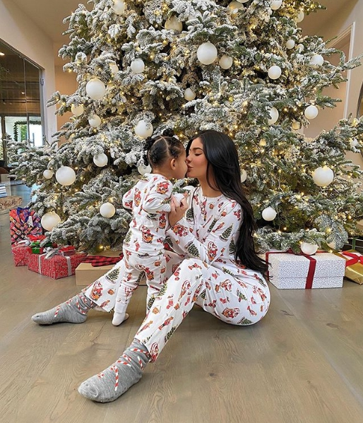 Kylie Jenner with daughter near the Christmas tree