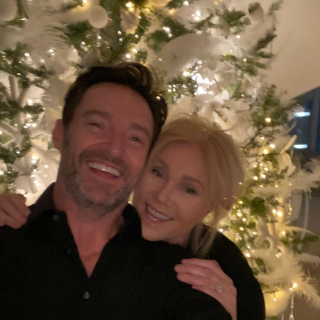 Hugh Jackman with his wife on the background of the Christmas tree