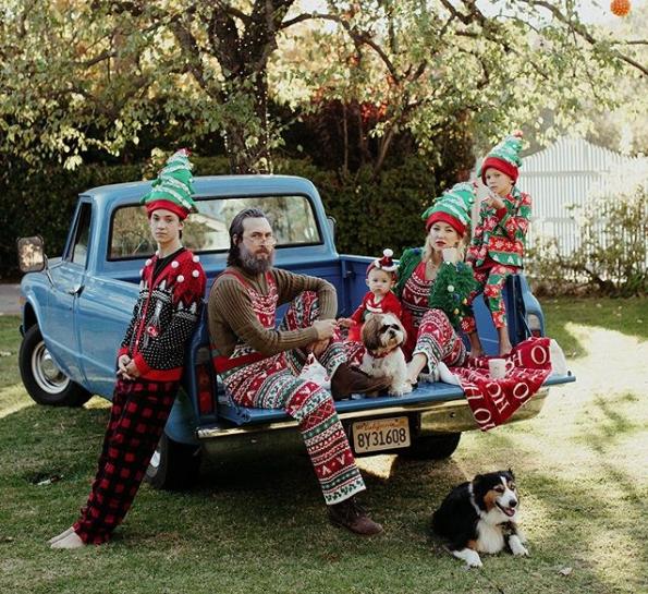 Kate Hudson family posing near car